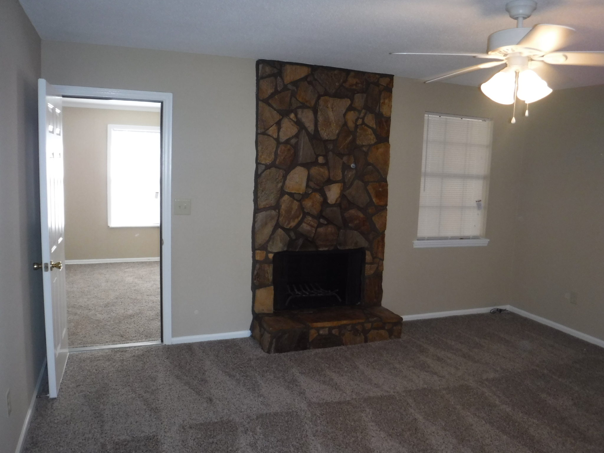 14 x 15 living room with brick fireplace and new ceiling