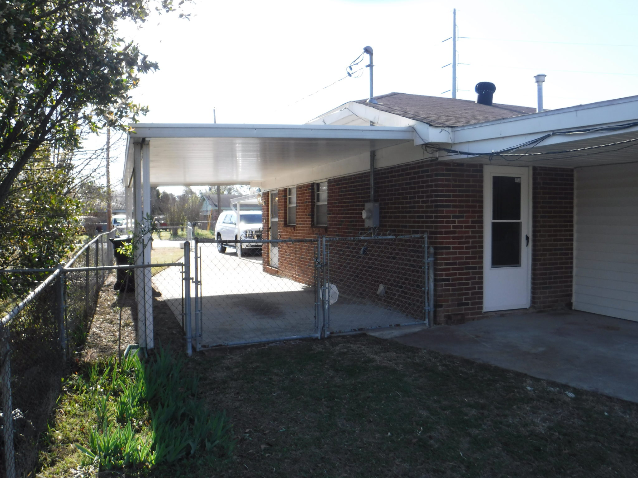 Side Of House With 8 X 12 Covered Back Porch Patio And View Of One Carport Veteran S Realty Of Augusta