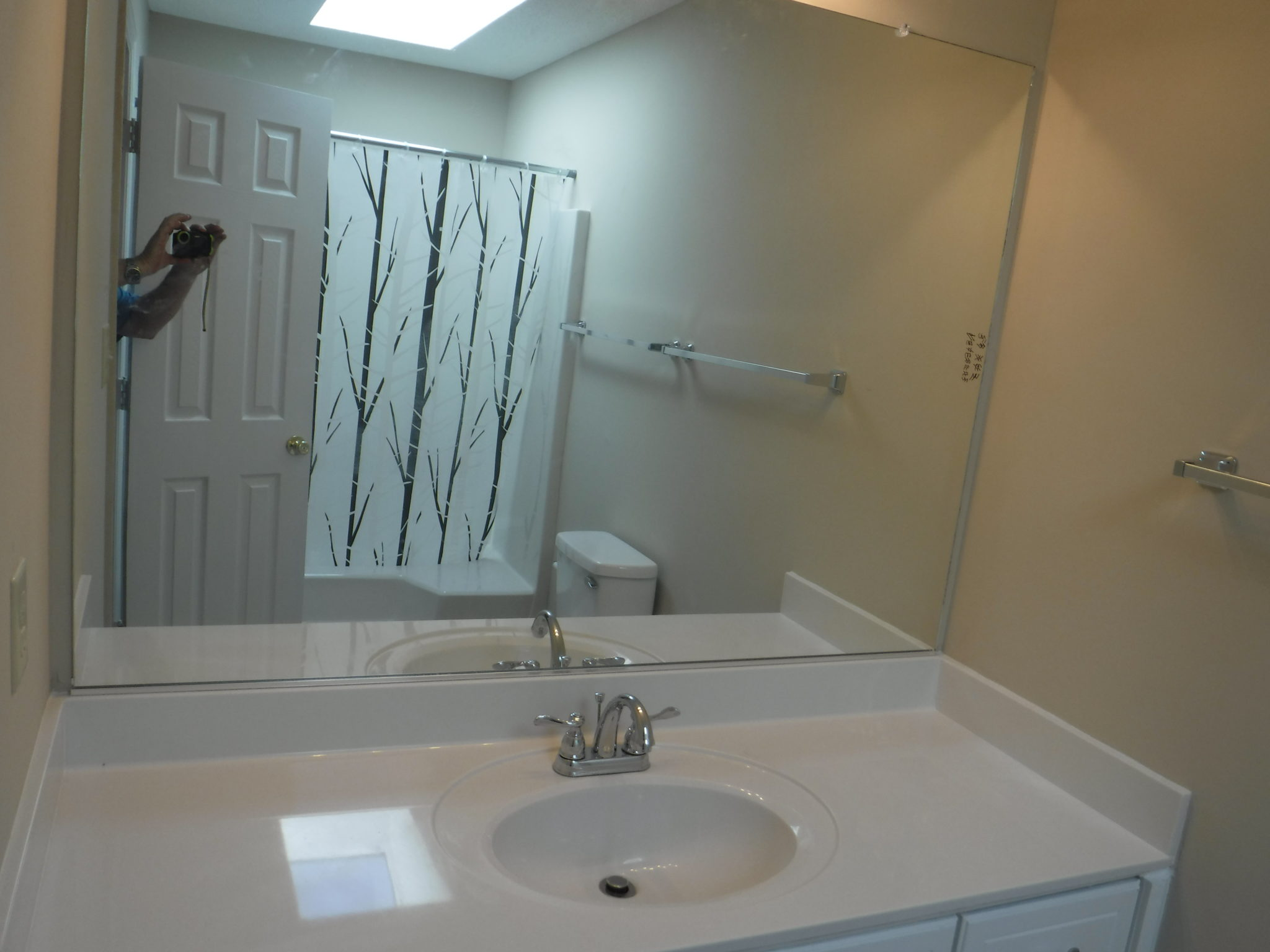 Owners private bath with skylight and garden tub shower